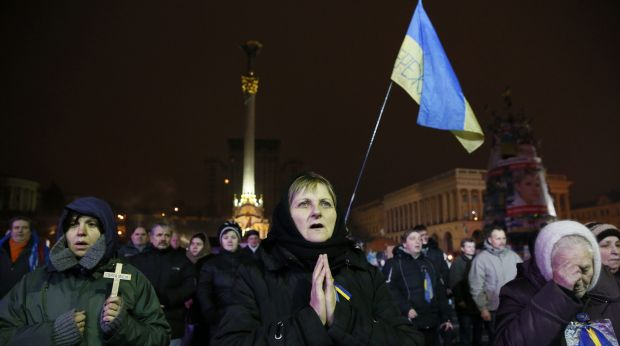 Pro-European Union protesters  pray during rally in Ukraine